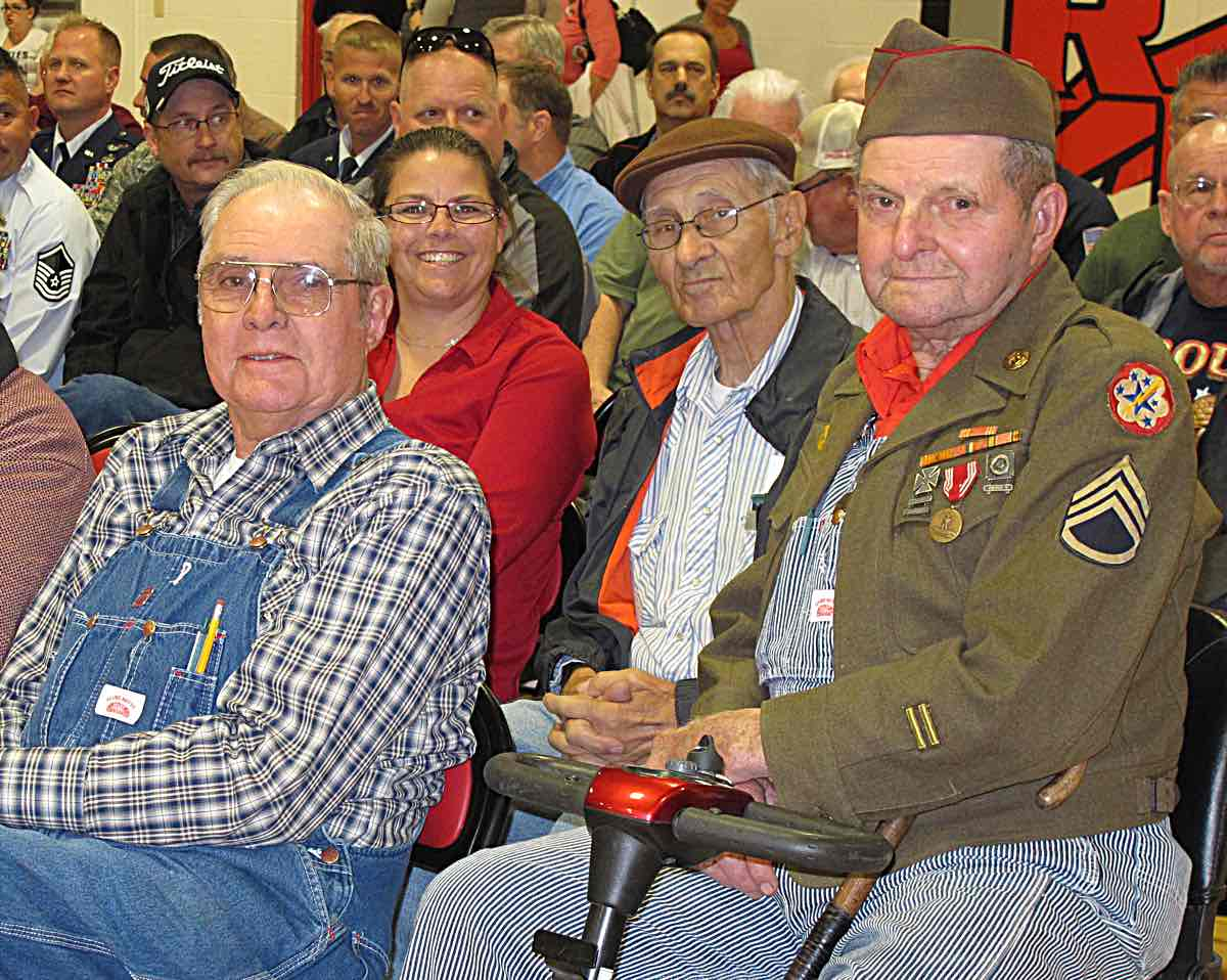 Marion is at the left and Marshall wears his World War II Army uniform jacket and hat.