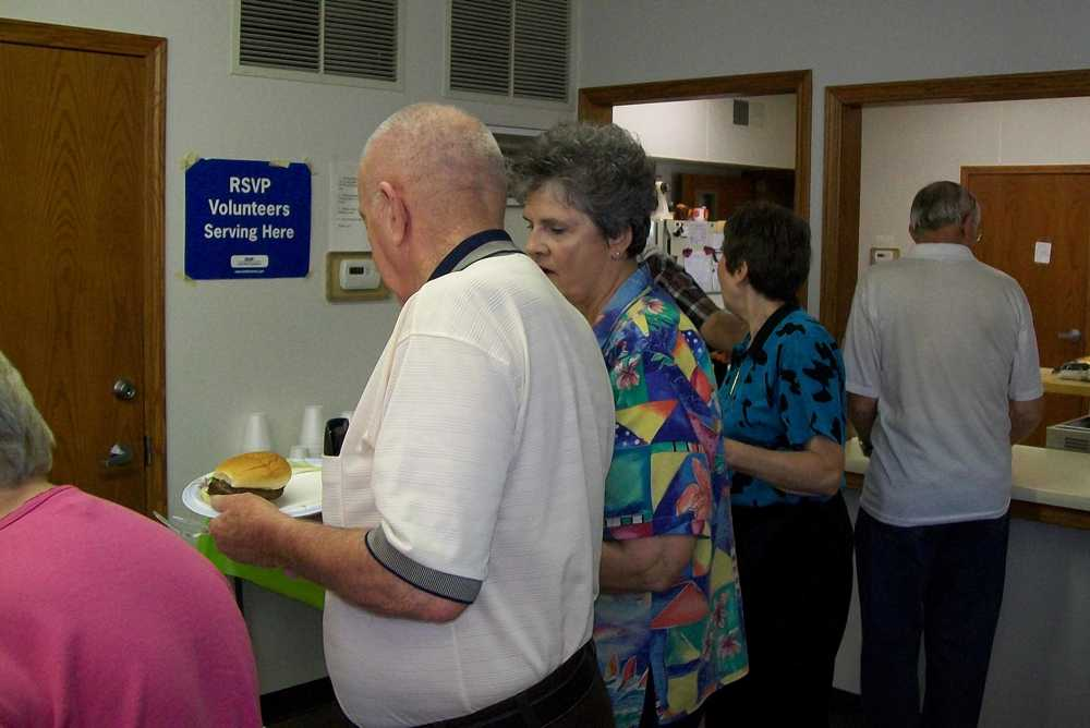 Larry Young and Carol Walton discuss the food.