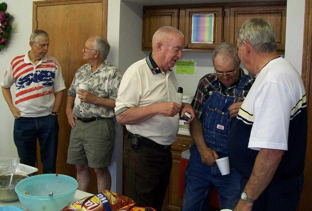 Jim Walton & Larry Webster visit while Larry, Marion & Dick trade stories.